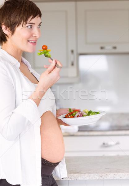 Pregnant woman eating a salad Stock photo © wavebreak_media