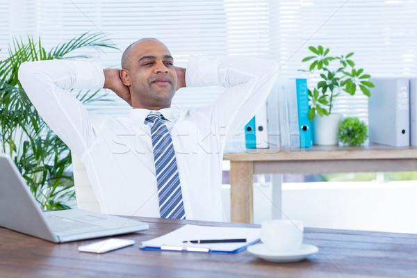 Relaxed businessman lying down in swivel chair Stock photo © wavebreak_media