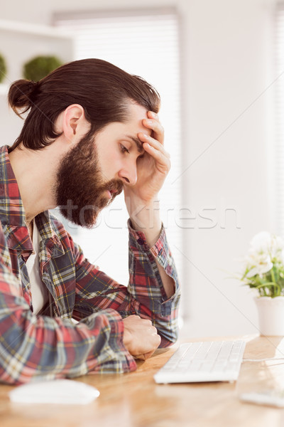 Hipster businessman stressed at his desk Stock photo © wavebreak_media