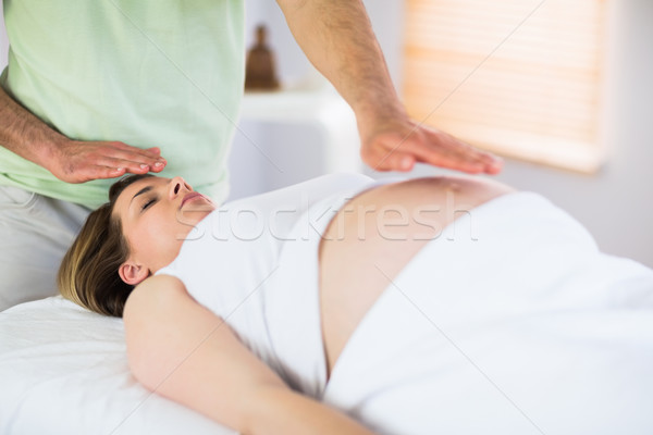Mulher grávida reiki tratamento estúdio corpo Foto stock © wavebreak_media