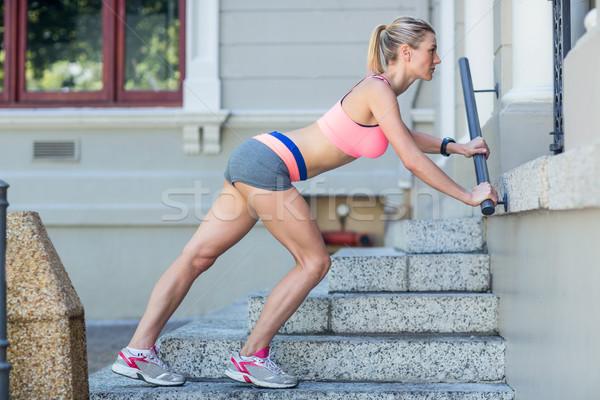 Csinos nő nyújtás lépcsősor napos idő város sport Stock fotó © wavebreak_media