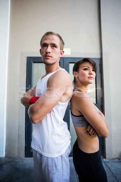 Extremo atletas em pé de volta edifício Foto stock © wavebreak_media