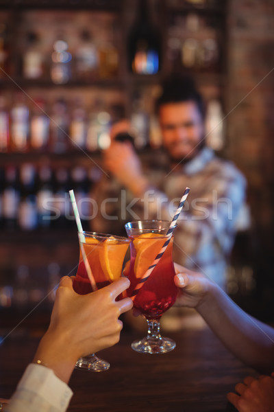 Hands of women toasting their cocktail drinks at counter Stock photo © wavebreak_media