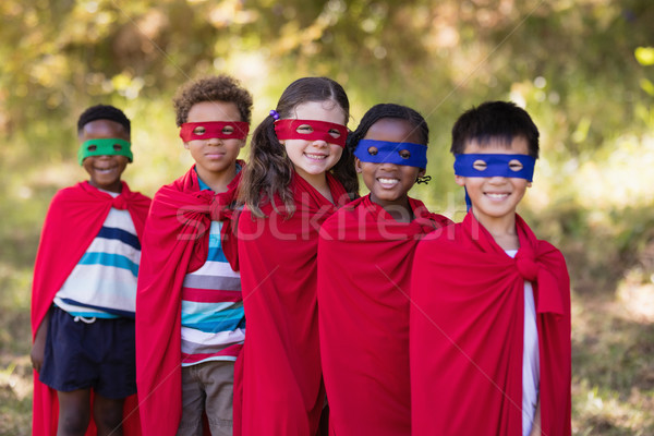 Friends in red superhero costumes standing at campsite Stock photo © wavebreak_media