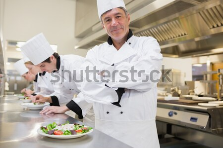 Portrait of happy chef with appetizer plates at order station Stock photo © wavebreak_media