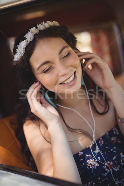 Close up of young woman listening music Stock photo © wavebreak_media