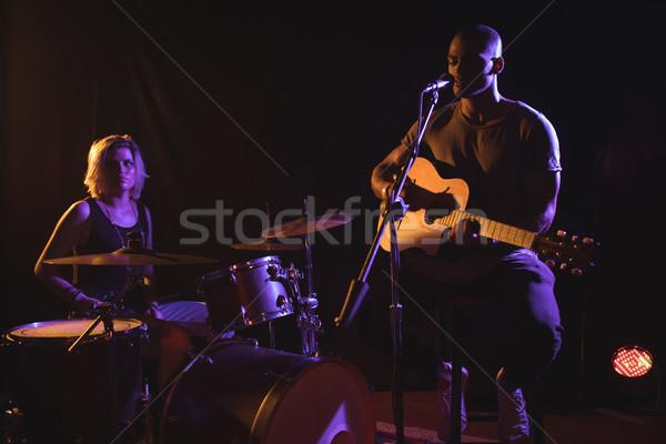 Singer performing with drummer in nightclub Stock photo © wavebreak_media
