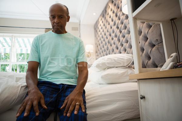 Thoughtful senior man sitting in bedroom Stock photo © wavebreak_media