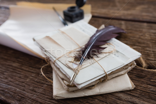 Quill feather with legal documents arranged on table Stock photo © wavebreak_media