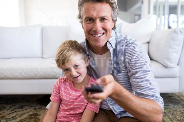 Apa fia tv nézés nappali otthon férfi televízió Stock fotó © wavebreak_media
