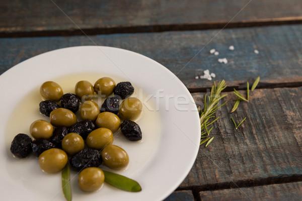 Groene drogen zwarte olijven olie plaat tabel Stockfoto © wavebreak_media