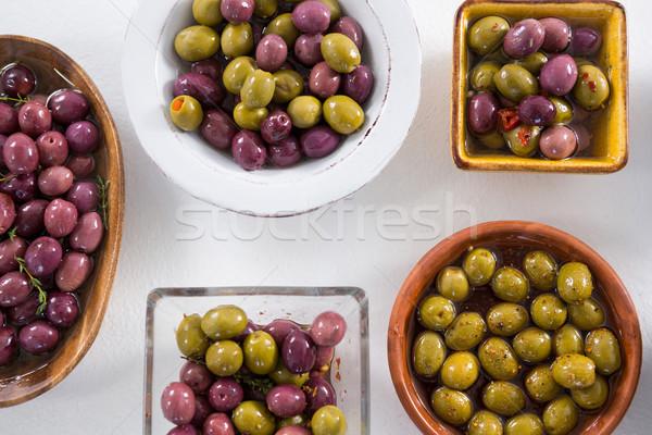 Pickled olives on white background Stock photo © wavebreak_media