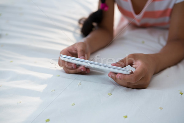Midsection of girl using mobile phone on bed Stock photo © wavebreak_media