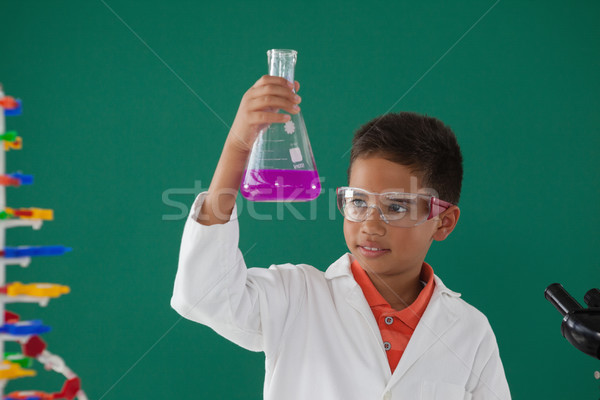 Attentive schoolboy doing a chemical experiment in laboratory Stock photo © wavebreak_media