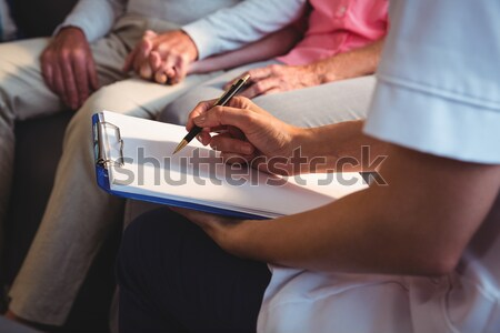 Midsection of senior man reading braille book at table Stock photo © wavebreak_media