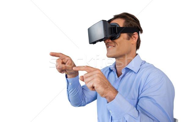 Smiling businessman with gestures using vr glasses Stock photo © wavebreak_media