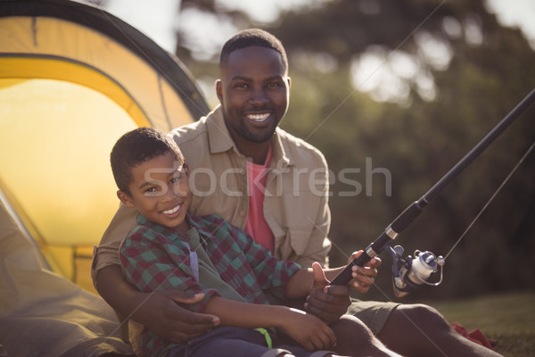 Father and son fishing together in park Stock photo © wavebreak_media