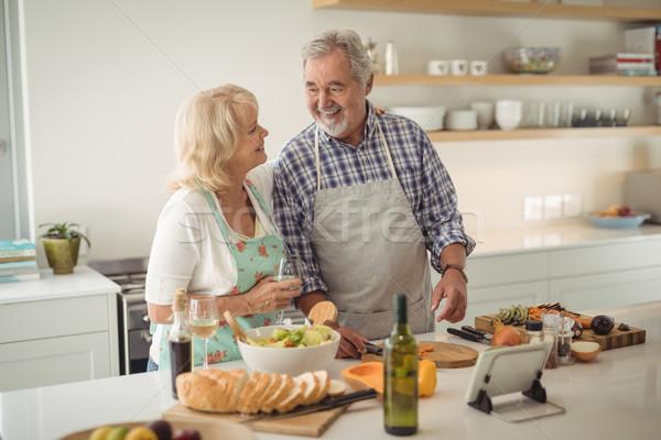 Senior couple preparing meal in kitchen Stock photo © wavebreak_media