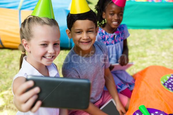 High angle view of children taking selfie Stock photo © wavebreak_media