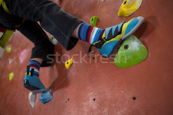 Boy practicing rock climbing in fitness studio Stock photo © wavebreak_media
