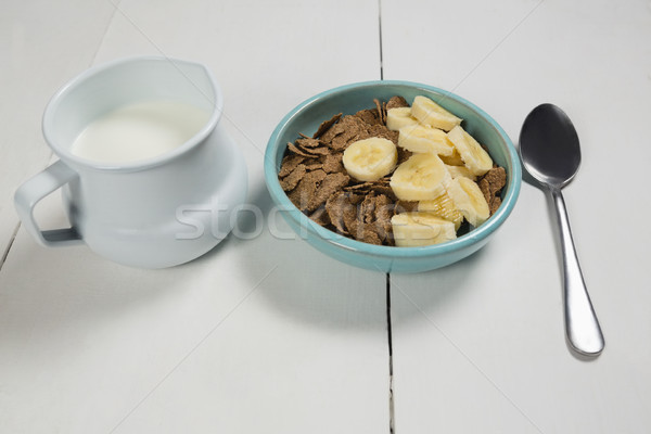 Búza pelyhek banán szelet tál tejesflakon Stock fotó © wavebreak_media