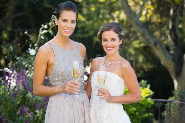 Portret bruid bruidsmeisje huwelijksceremonie champagne Stockfoto © wavebreak_media