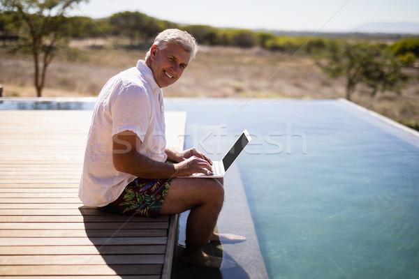男 ラップトップを使用して サファリ 休暇 肖像 笑みを浮かべて ストックフォト © wavebreak_media