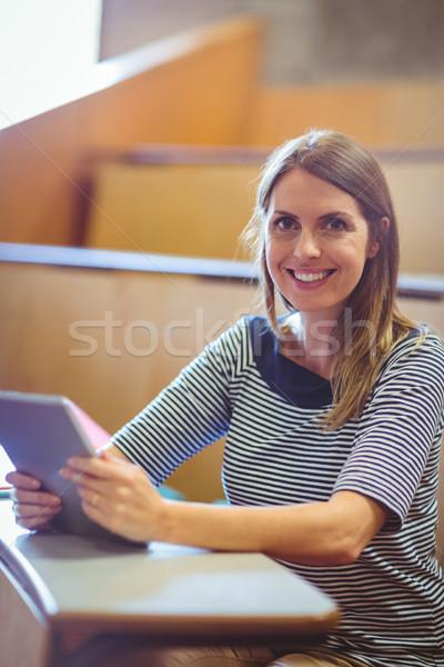 Mature student in lecture hall Stock photo © wavebreak_media