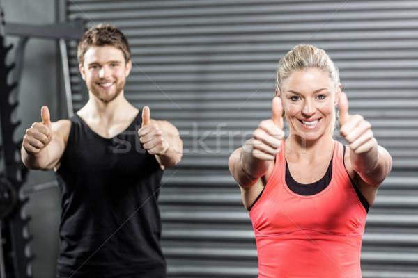 Fitt pár remek crossfit tornaterem kezek Stock fotó © wavebreak_media