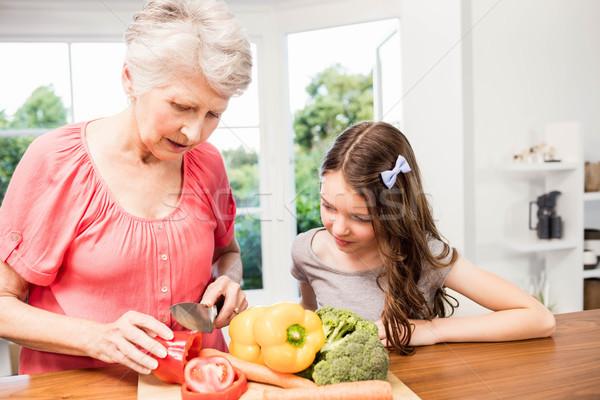 Grandmother and granddaughter slicing vegetables Stock photo © wavebreak_media