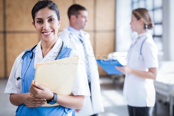 медсестры улыбаясь камеры больницу служба заседание Сток-фото © wavebreak_media