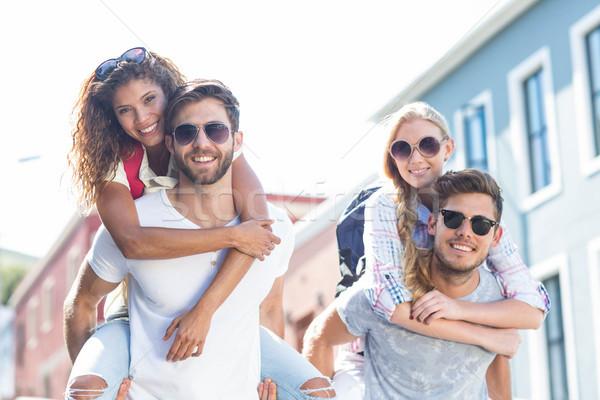 Csípő férfiak malac hát barátnők utca Stock fotó © wavebreak_media