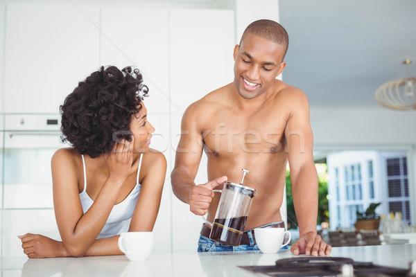 Happy couple drinking coffee in the kitchen Stock photo © wavebreak_media