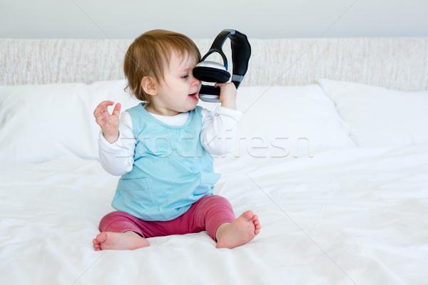 adorable baby playing with headphones Stock photo © wavebreak_media