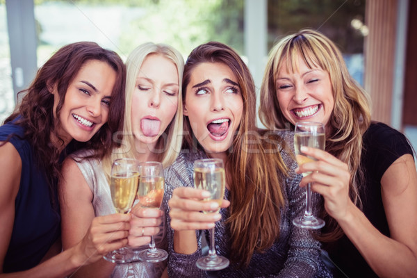 Gyönyörű nők készít vicces arcok portré Stock fotó © wavebreak_media