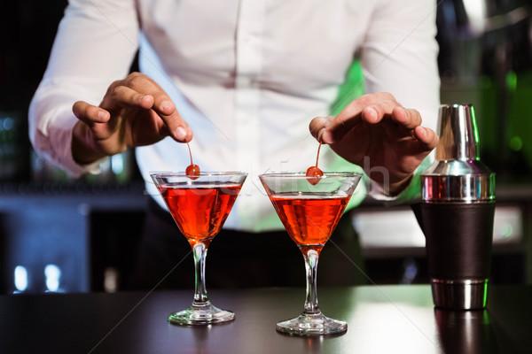 Bartender garnishing cocktail with cherry Stock photo © wavebreak_media