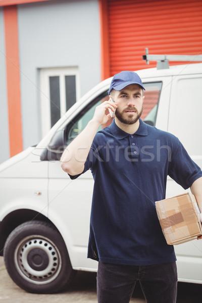 Delivery man making a phone call Stock photo © wavebreak_media