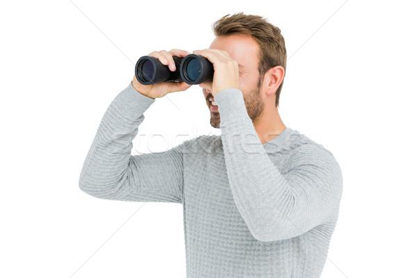 Młody człowiek patrząc człowiek uśmiechnięty mężczyzna wizji Zdjęcia stock © wavebreak_media