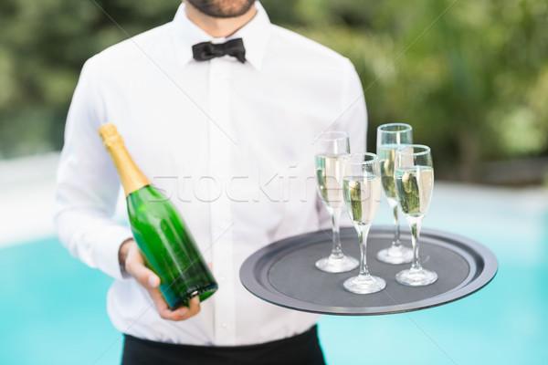 Cameriere champagne flauti bottiglia lavoro Foto d'archivio © wavebreak_media
