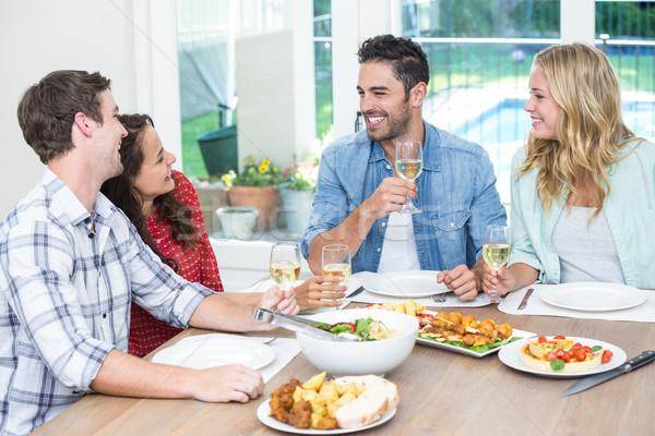 улыбаясь друзей Бокалы сидят таблице Сток-фото © wavebreak_media