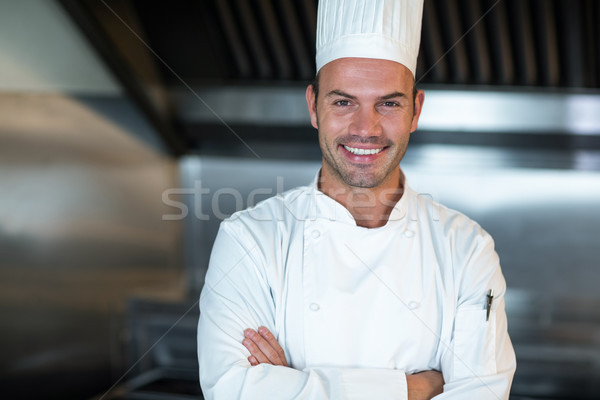 Szczęśliwy kucharz handlowych kuchnia portret człowiek Zdjęcia stock © wavebreak_media