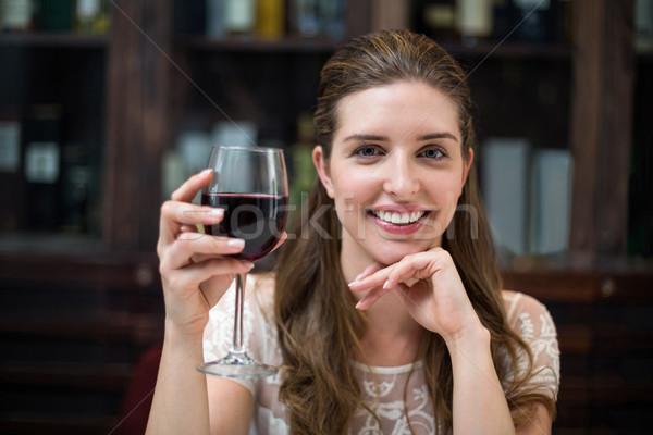 Portrait of happy woman holding wine glass Stock photo © wavebreak_media