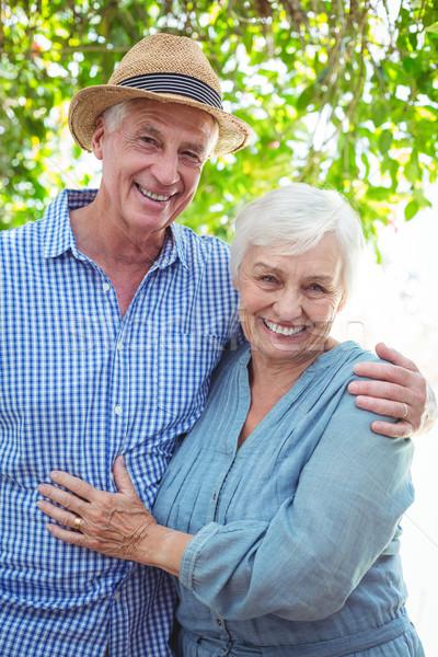 Confident senior couple with arm around Stock photo © wavebreak_media
