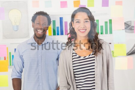 Close up of smiling colleagues looking at sticky notes Stock photo © wavebreak_media