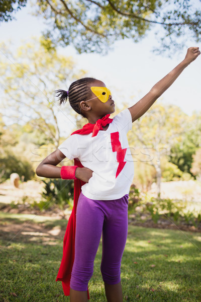 A little girl pretending to fly with superhero costume Stock photo © wavebreak_media
