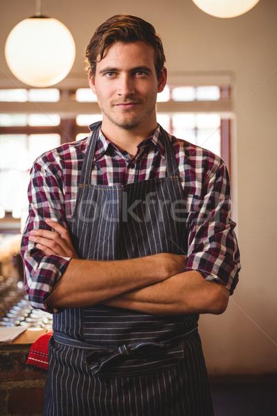 Portrait of waiter standing with arms crossed Stock photo © wavebreak_media