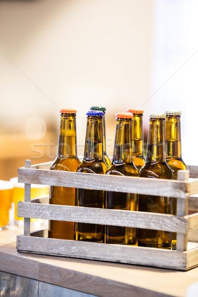 Close-up of beer bottles in crate Stock photo © wavebreak_media
