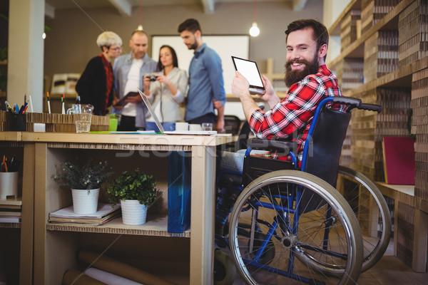 Portrait of disabled businessman using digital tablet Stock photo © wavebreak_media