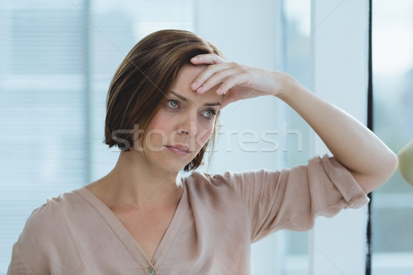 Sad woman standing at home Stock photo © wavebreak_media