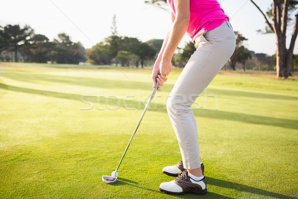 Mujer golfista tiro campo deporte Foto stock © wavebreak_media
